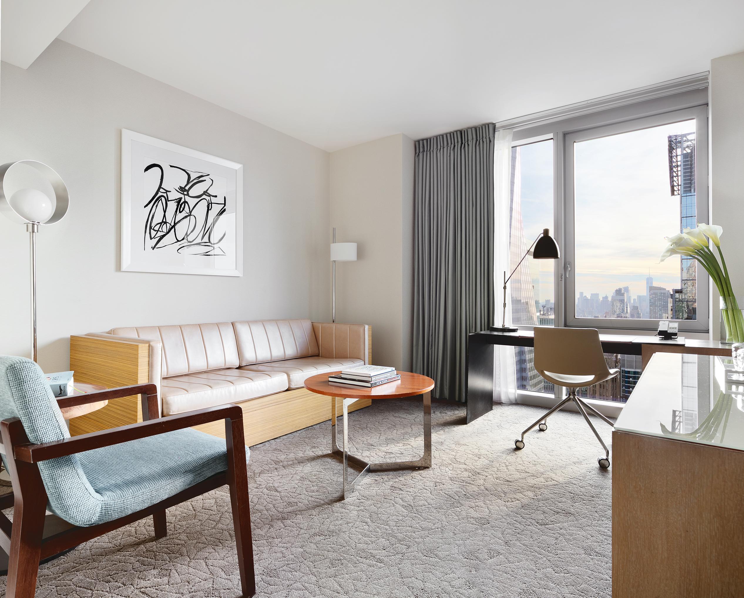 https://www.hotelsbyday.com/_data/default-hotel_image/1/7047/deluxe-suite-living-room-lores.jpg