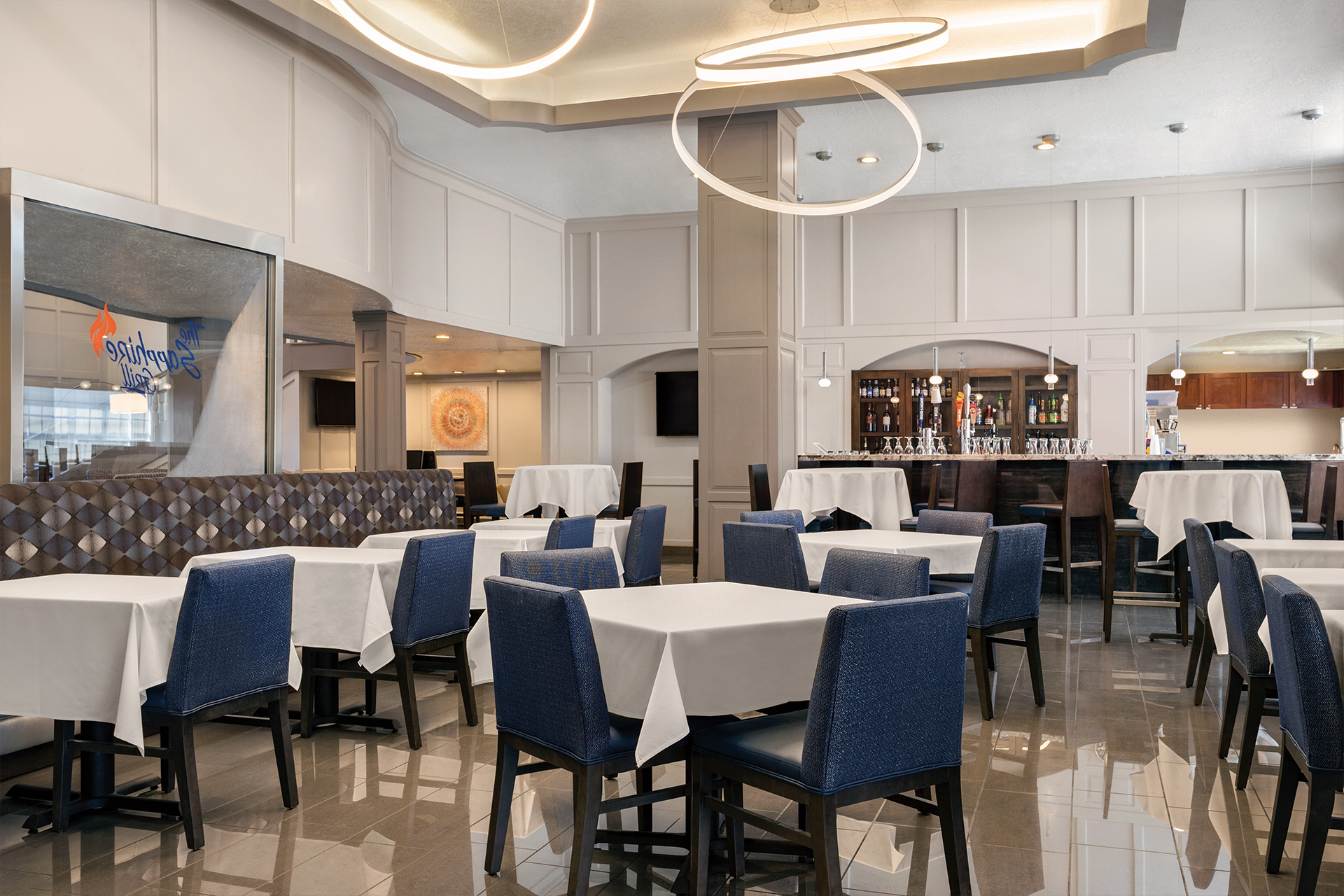 https://www.hotelsbyday.com/_data/default-hotel_image/2/10042/the-sapphire-grill-at-radisson.jpg