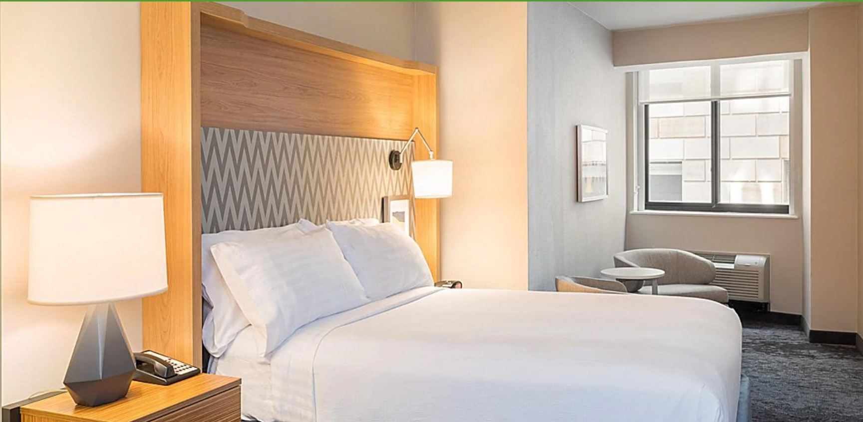 https://www.hotelsbyday.com/_data/default-hotel_image/2/12817/holiday-inn-manhattan.jpg